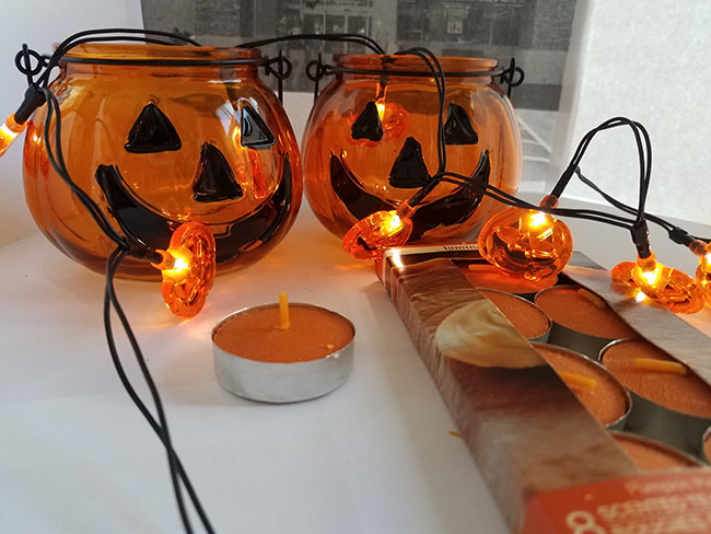 dollar tree candle holders and light up pumpkins